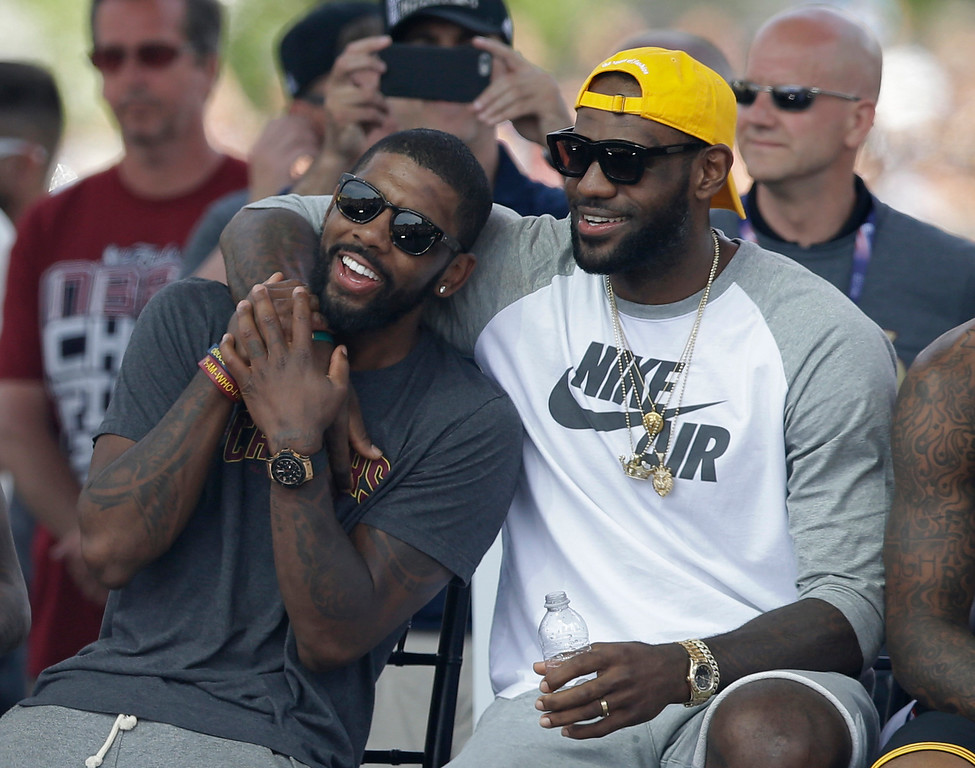 . Cleveland Cavaliers\' LeBron James, right, and Kyrie Irving hug during a rally Wednesday, June 22, 2016, in Cleveland. The Cavaliers made history by overcoming a 3-1 deficit to beat the Golden State Warriors in the NBA Finals and end the city\'s 52-year drought without a professional sports championship. (AP Photo/Tony Dejak)