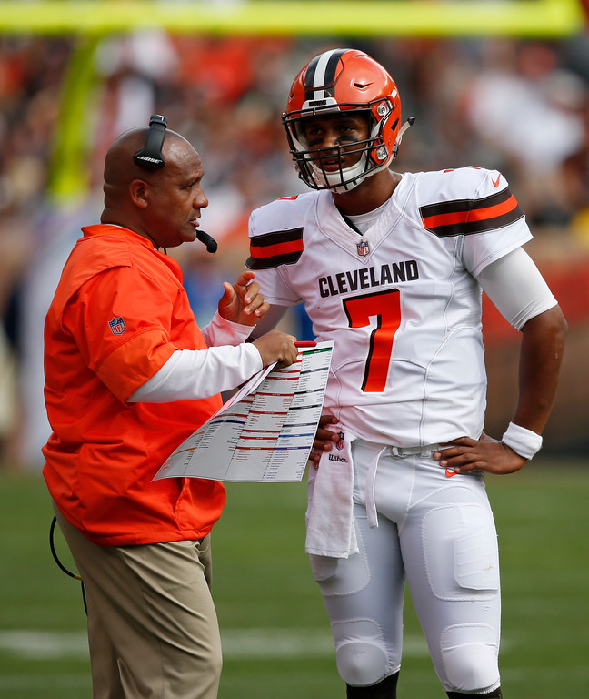 . Cleveland Browns quarterback DeShone Kizer, right, talks with head coach Hue Jackson during the first half of an NFL football game against the New York Jets, Sunday, Oct. 8, 2017, in Cleveland. (AP Photo/Ron Schwane)