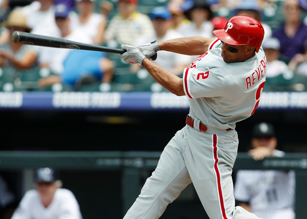 . Philadelphia Phillies\' Ben Revere singles against the Colorado Rockies in the first inning of a baseball game in Denver, Saturday, June 15, 2013. (AP Photo/David Zalubowski)