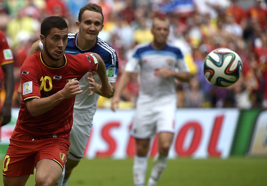 . Belgium\'s midfielder Eden Hazard (L) vies for the ball with Russia\'s defender Aleksei Kozlov, during a Group H football match between Belgium and Russia at the Maracana Stadium in Rio de Janeiro during the 2014 FIFA World Cup on June 22, 2014.    MARTIN BUREAU/AFP/Getty Images