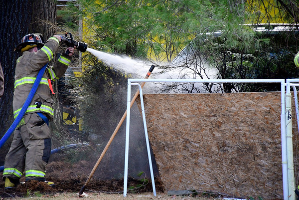 3/10/2020 Mike Orazzi | Staff Terryville firefighters while on scene of a grass fire that extended to two homes on Sandra Avenue on Tuesday afternoon.