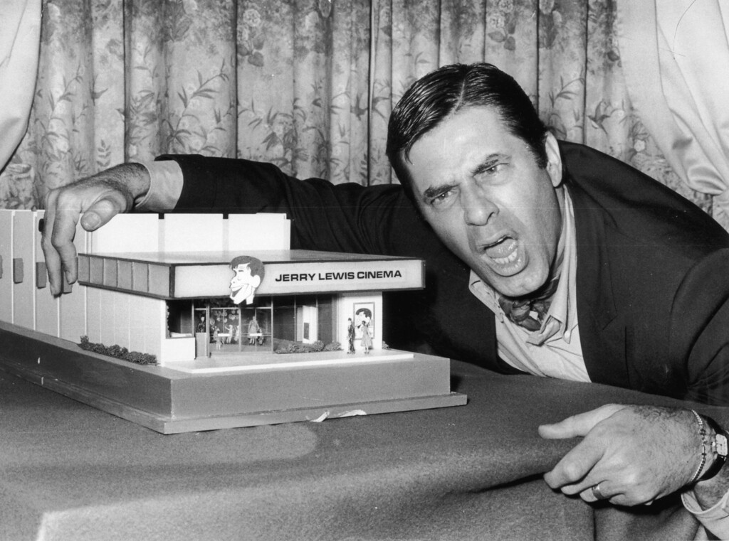 . 22nd April 1971:  American comedian and film star Jerry Lewis with a model of the \'Jerry Lewis Cinema\'.  (Photo by Evening Standard/Getty Images)