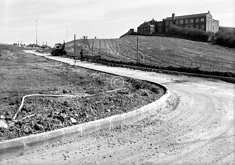 This photo needed a little research, for although I had a rough date (late April or May 1975) I had no note or recollection of where or why I took it. School on the hill, couldn't find a match, but then I noticed the motorway-standard lighting and barriers top left, so which m/way was nearing completion at that date? Answer was Phase 1 of the Monkland, Townhead to Cumbernauld Rd. Things began to fall into place, and the school was identifiable as the old Riddrie Primary (where there is now the circle of houses at the top of Leader St.). So, for what it's worth, I present the Blochairn/Parkhead off-slip from J13 on the westbound M8.   Incidentally, the tyre tracks coming down from the level part of the hill are on the site of the famous Inclined Plane on the Monkland Canal, by means of which barges bringing coal to the city from Lanarkshire could bypass the Blackhill Locks with a 90% saving on time.