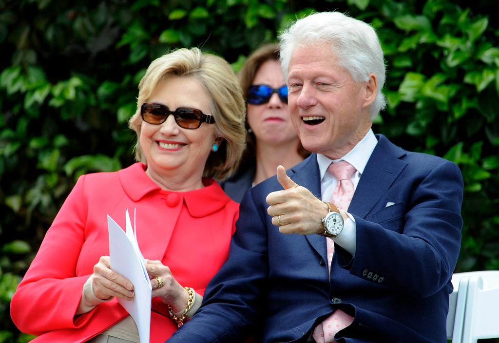 . Former President Bill Clinton gives the thumbs-up as Democratic presidential candidate Hillary Clinton smiles during the Loyola Marymount 2016 Commencement on the campus of Loyola Marymount University on Saturday, May 7, 2016 in Los Angeles.    (Photo by Libby Cline)
