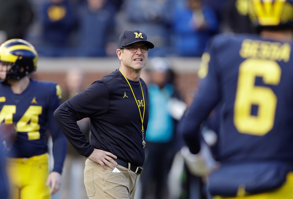 . Michigan head coach Jim Harbaugh watches warmups before the first half of an NCAA college football game against Ohio State, Saturday, Nov. 25, 2017, in Ann Arbor, Mich. (AP Photo/Carlos Osorio)
