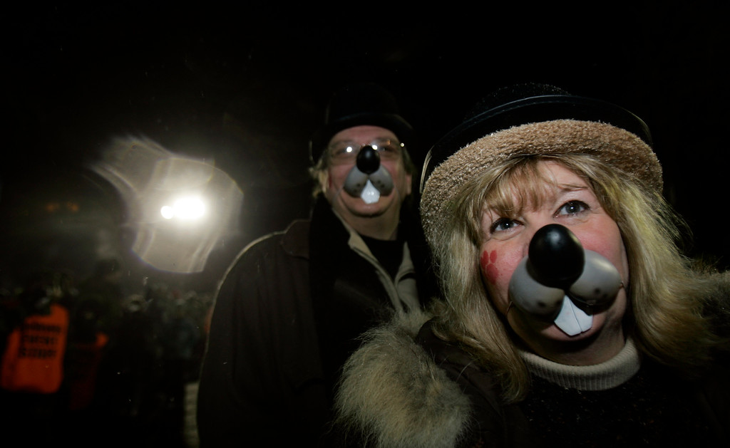 . Rosemarie Drummond, of Cortland, Ohio, right, and Jerry Grgruich of Hermitage, Pa., wear groundhog faces as they join one of the largest crowds ever who came to hear Punxsutawney Phil\'s prediction of an early spring in Punxsutawney, Pa., Friday, Feb. 2, 2007.  (AP Photo/Carolyn Kaster)