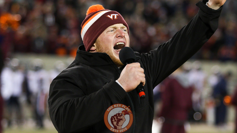 "Former Virginia Tech player Sam Rogers leads the crowd in a ""Lets Go Hokies"" chant between the 3rd and 4th quarters. (Mark Umansky/TheKeyPlay.com)"