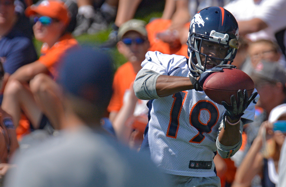 . Denver Broncos WR Lamar Thomas catches a pass during training camp July 26, 2013 at Dove Valley. (Photo By John Leyba/The Denver Post)