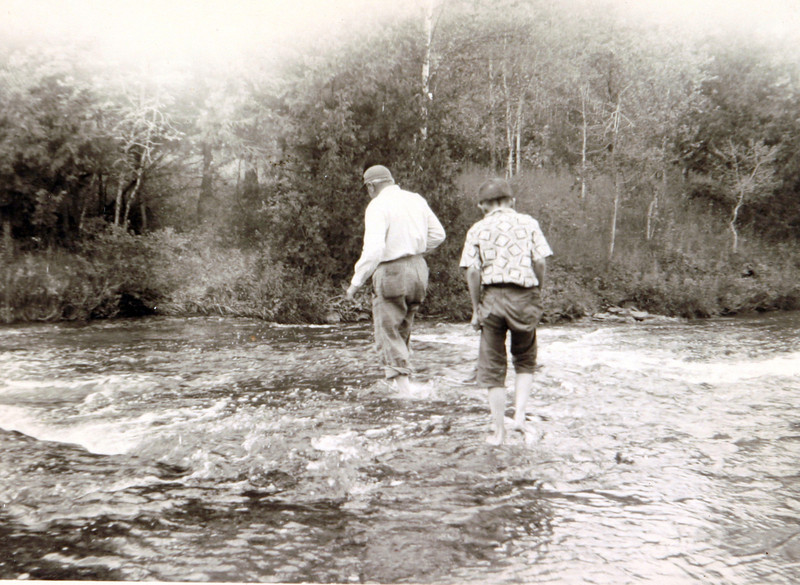 Uncle Norm & Edwin wading in water.JPG