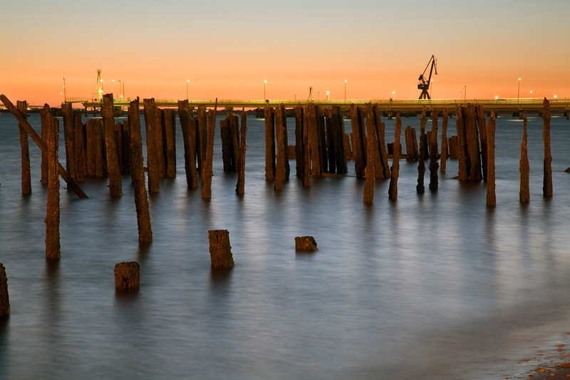 Remains of an old mooring with new industrial facilities on the background, chemical center, town of Huelva, Andalusia, southwestern Spain