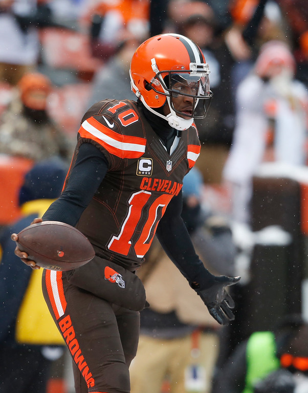 . Cleveland Browns quarterback Robert Griffin III (10) reacts after a one-yard touchdown in the second half of an NFL football game against the Cincinnati Bengals, Sunday, Dec. 11, 2016, in Cleveland. (AP Photo/Ron Schwane)