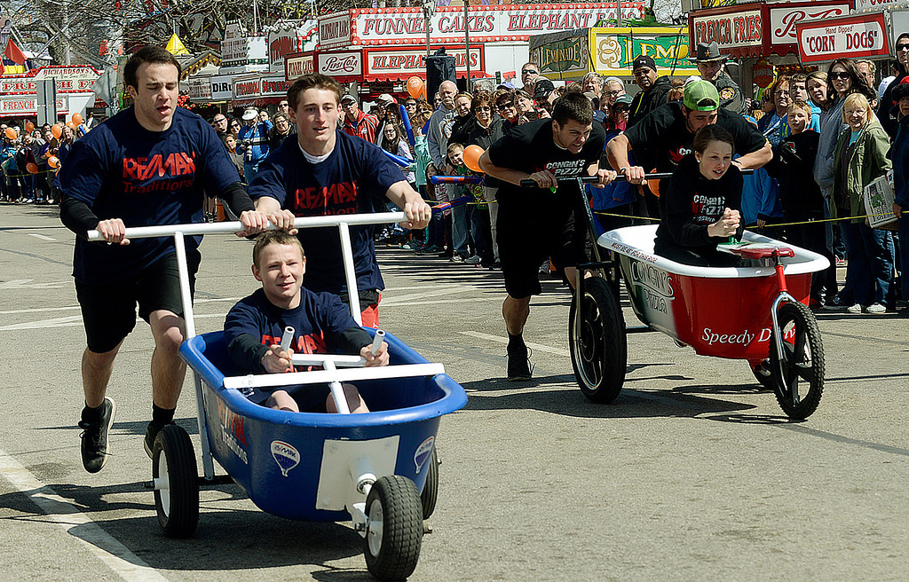 . Maribeth Joeright/MJoeright@News-Herald.com Taking first place in the 30 and under division is the ReMax team of Evan Hornyak, driving, James Knopp, left, and Patrick Sullivan in the popular bathtub race event during the 85th annual Geauga County Maple Festival.