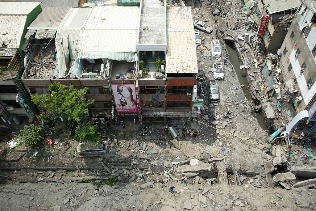 . An aerial view shows the damage from a massive gas explosion in Kaohsiung, Taiwan, Friday, Aug. 1, 2014. A series of powerful gas explosions ripped through a port city in southern Taiwan midnight Thursday, killing scores of people and injuring more than 200 others, Taiwan\'s National Fire Agency said Friday. (AP Photo/Wally Santana)