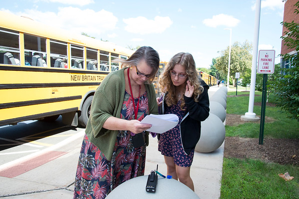 08/29/19 Wesley Bunnell | Staff Berlin High School students exit school after the first day of classes on Thursday August 29, 2019. Barbara Ventura helps a student find her correct bus.
