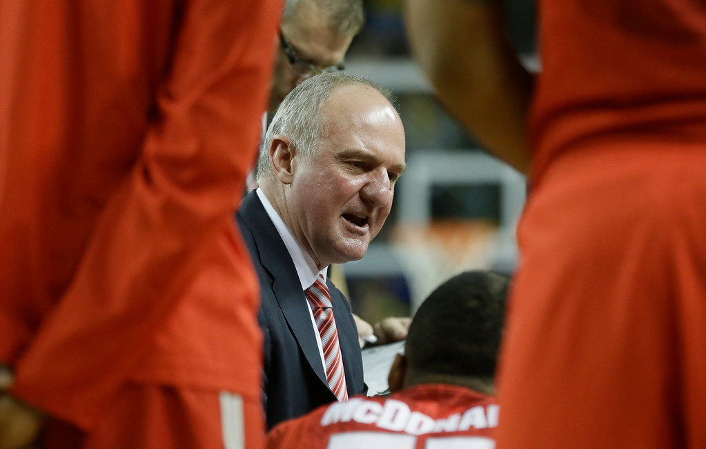 . Ohio State head coach Thad Matta talks to his team during the first half of an NCAA college basketball game against Michigan, Sunday, Feb. 22, 2015 in Ann Arbor, Mich. (AP Photo/Carlos Osorio)