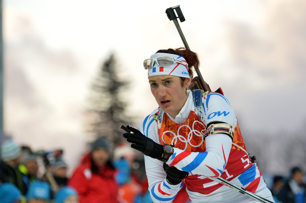 . France\'s Marie Laure Brunet competes in the Women\'s Biathlon 4x6 km Relay at the Laura Cross-Country Ski and Biathlon Center during the Sochi Winter Olympics on February 21, 2014, in Rosa Khutor, near Sochi. (ALBERTO PIZZOLI/AFP/Getty Images)