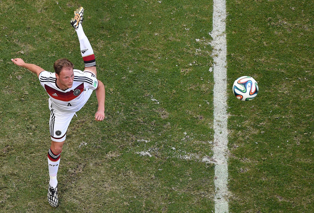 . Germany\'s defender Benedikt Hoewedes controls the ball during the Group G football match between Germany and Portugal at the Fonte Nova Arena in Salvador on June 16, 2014, during the 2014 FIFA World Cup.      AFP PHOTO / /POOL FRANCOIS XAVIER MARIT/AFP/Getty Images