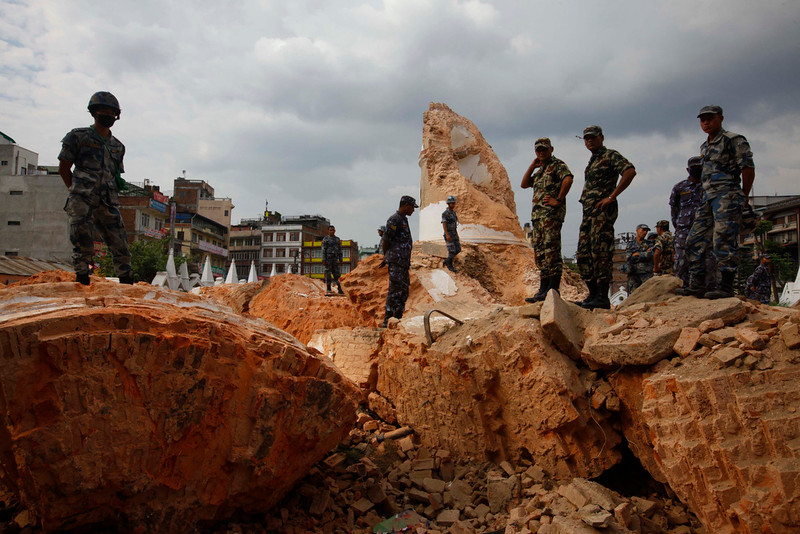 . Nepalese policemen inspect the debris of one of Kathmandu \'s landmark Bhimsen tower after it was damaged in Saturdayís earthquake, in Kathmandu, Nepal, Sunday, April 26, 2015. The earthquake centered outside Kathmandu, the capital, was the worst to hit the South Asian nation in over 80 years. It destroyed swaths of the oldest neighborhoods of Kathmandu, and was strong enough to be felt all across parts of India, Bangladesh, China\'s region of Tibet and Pakistan. (AP Photo/Niranjan Shrestha)