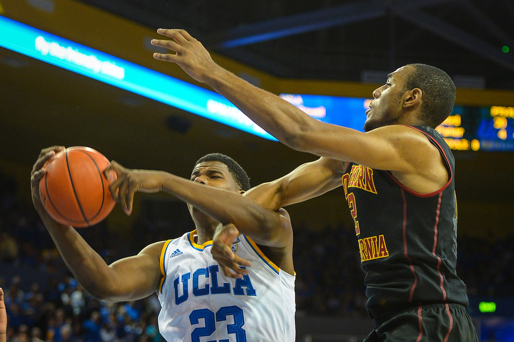 . UCLA�s Tony Parker is fouled by USC�s Roschon Prince during game action at Pauley Pavilion Sunday, December 5, 2014. UCLA  defeated USC 107-73.  Photo by David Crane/Los Angeles Daily News.