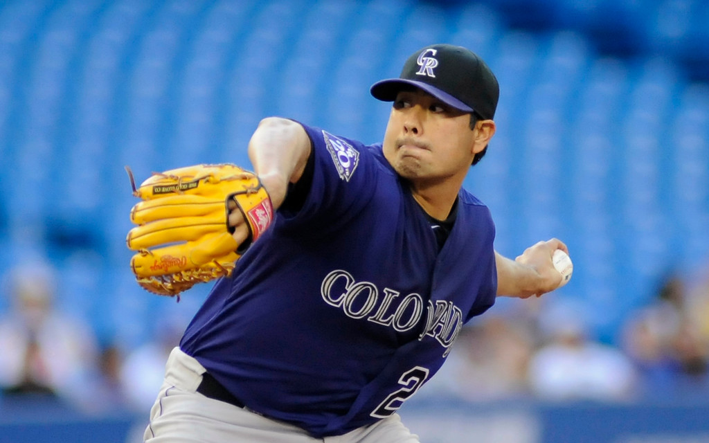 . Colorado Rockies\' Jorge De La Rosa pitches against the Toronto Blue Jays during the second inning of their MLB interleague baseball game in Toronto June 17, 2013.   REUTERS/Jon Blacker