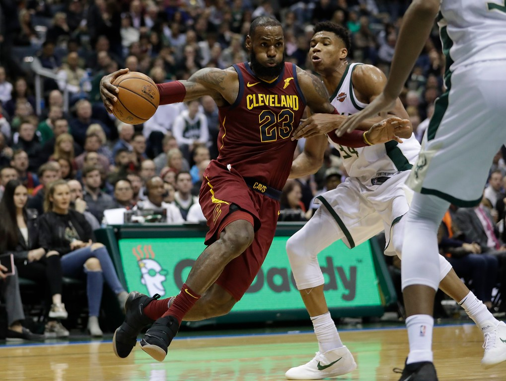 . Cleveland Cavaliers\' LeBron James drives past Milwaukee Bucks\' Giannis Antetokounmpo during the first half of an NBA basketball game Tuesday, Dec. 19, 2017, in Milwaukee. (AP Photo/Morry Gash)