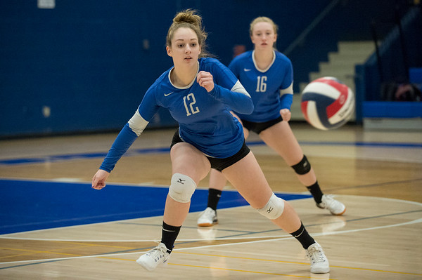 10/21/19 Wesley Bunnell | StaffrrPlainville High School girls volleyball vs visiting Berlin High on Monday night. Plainville's Margaret Cronkhite (12) chases a ball that would go out of bounds.