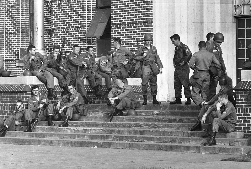 . Members of the Alabama National Guard mark time outside an armory in Birmingham, Ala. as they prepare to go on duty at three schools which have been ordered integrated, Sept. 10, 1963. Gov. George Wallace, who barred black students from the schools, called the guard to duty. (AP Photo)