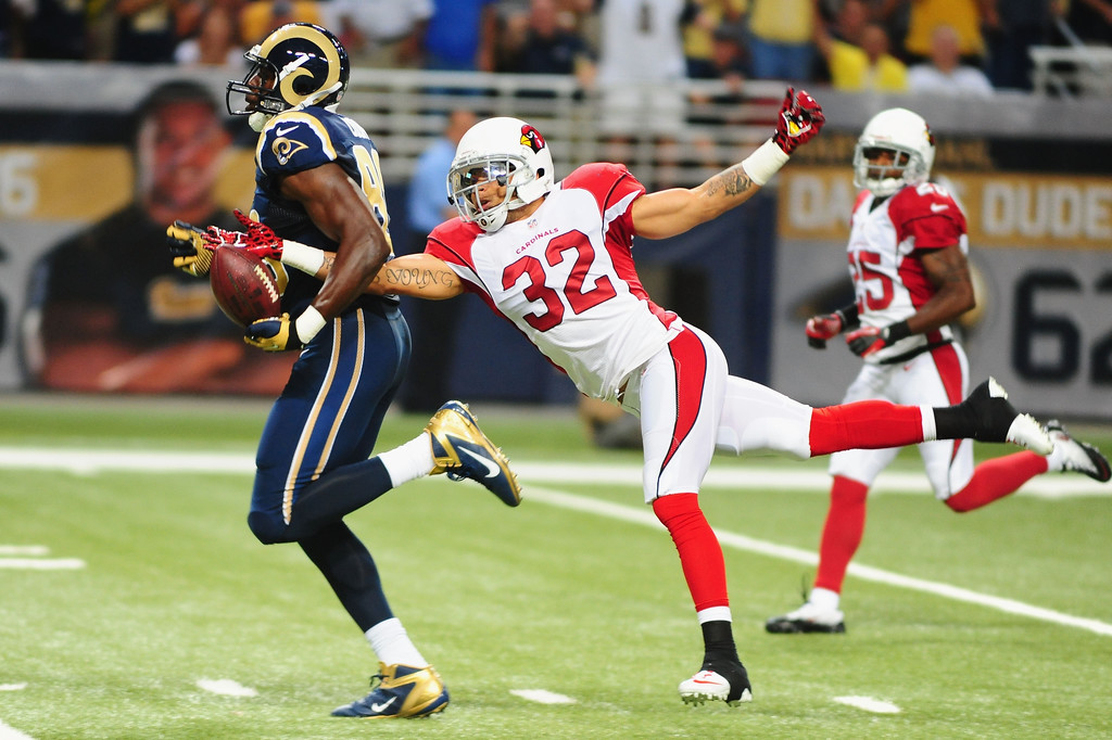 . Safety Tyrann Mathieu #32 of the Arizona Cardinals strips the ball from tight end Jared Cook #89 of the St. Louis Rams at the Edward Jones Dome on September 8, 2013 in St. Louis, Missouri.  (Photo by Michael Thomas/Getty Images)