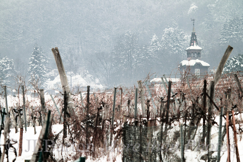 Salmannsdorf 2013-01-27  More vineyards in 'upper Vienna' waiting for spring.  I'm not sure what building that is - Ill check when the weather gets warmer.  -12C last night (10F).  Much too cold for Vienna. Many thanks for the comments on yesterday's vineyard shot - I'll try it as B&W.  The B&W version is here:  http://www.jerrybarton.eu/gallery/7986304_r9xtwT#!i=2337933621&k=hBN5qk6