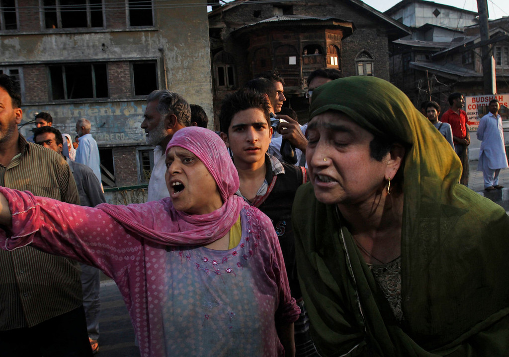 . Kashmiri women shout slogans during a protest after paramilitary troops opened fire on a car when the driver allegedly failed to stop at a police barricade in Srinagar, India, Saturday, Sept. 7, 2013. A protest erupted Saturday after Indian police said they killed two alleged militants and two civilians in the disputed Himalayan territory of Kashmir, while authorities maintained tight security for a classical music concert being staged amid separatist objections. The driver was hospitalized in critical condition. (AP Photo/Mukhtar Khan)