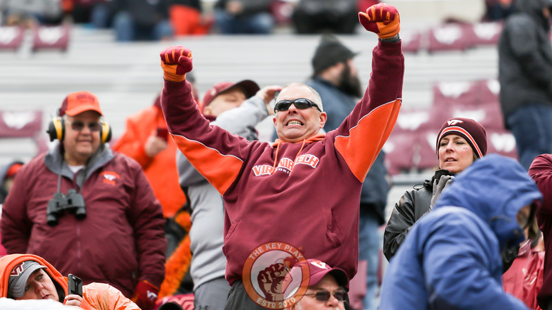 A fan in the stands cheers during a promotion on Hokievision. (Mark Umansky/TheKeyPlay.com