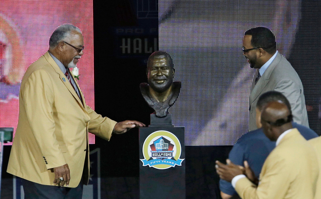 . Curley Culp smiles as he looks at his bust after his son, Chad unveiled it during the induction ceremony at the Pro Football Hall of Fame Saturday, Aug. 3, 2013, in Canton, Ohio. (AP Photo/Tony Dejak)
