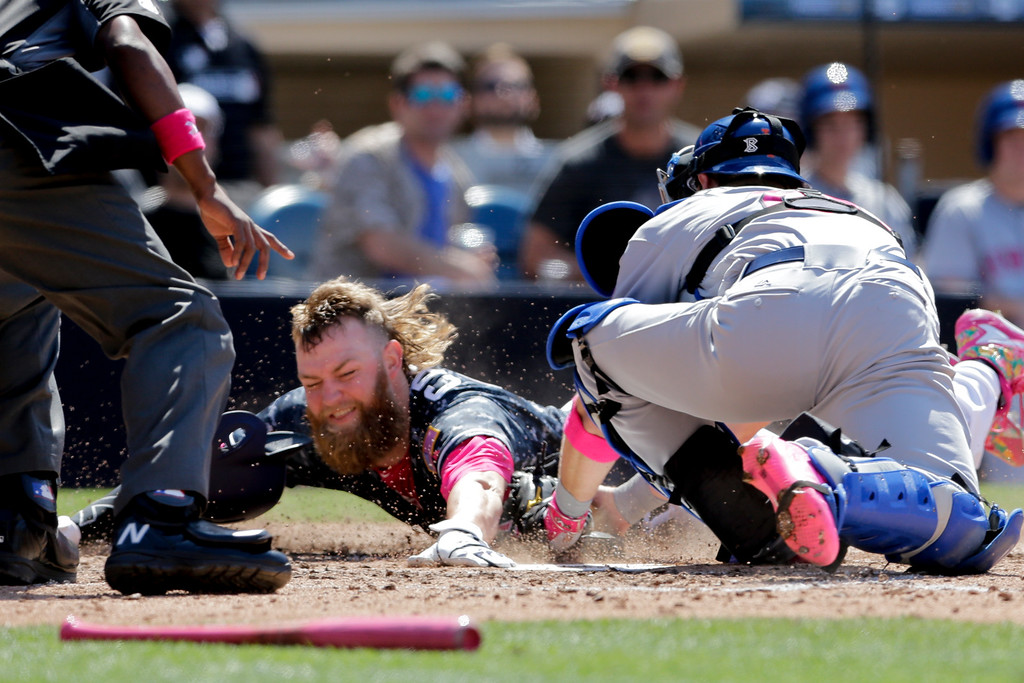 . San Diego Padres\' Andrew Cashner, center, is tagged out at home by New York Mets catcher Kevin Plawecki during the fifth inning of a baseball game Sunday, May 8, 2016, in San Diego. (AP Photo/Gregory Bull)