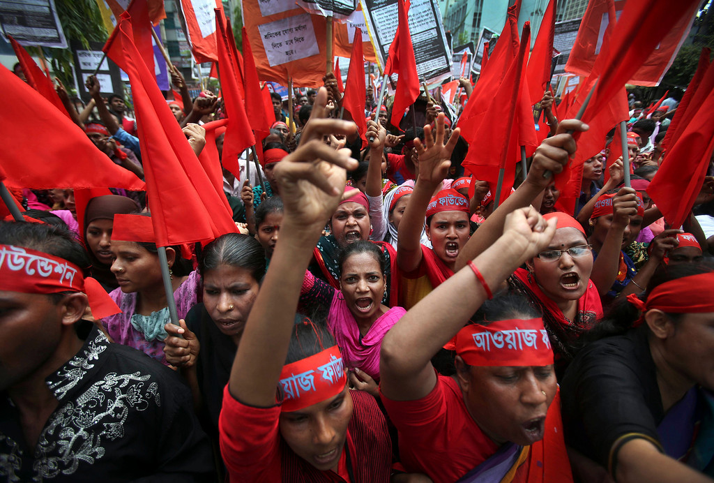 . Women protesters shout slogans calling for better working conditions for garment workers during a May Day rally on Wednesday May 1, 2013 in Dhaka, Bangladesh.  (AP Photo/Wong Maye-E)