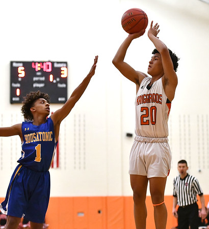 1/28/2020 Mike Orazzi | StaffrTerryville's Devonne Dao (20) and Housatonic Regional's Ivan Pascasio (1) during Tuesday night's boys basketball game at THS.