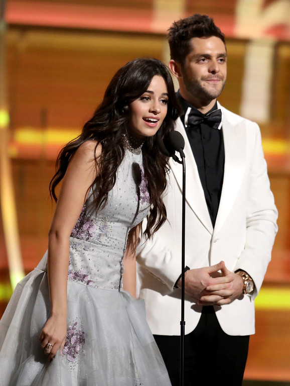 . Camila Cabello, left, and Thomas Rhett present the award for best country solo performance at the 59th annual Grammy Awards on Sunday, Feb. 12, 2017, in Los Angeles. (Photo by Matt Sayles/Invision/AP)
