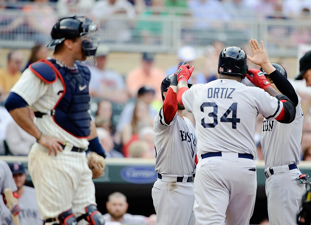 . Ryan Doumit looks on as Dustin Pedroia and Jacoby Ellsbury of the Boston Red Sox congratulate teammate David Ortiz on his three-run home run. (Photo by Hannah Foslien/Getty Images)
