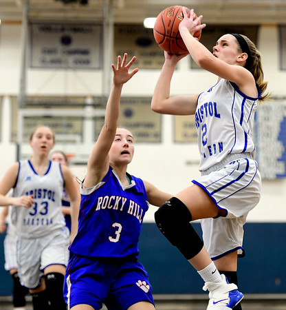 2/9/2019 Mike Orazzi | Staff Bristol Eastern's Paige McLaughlin (2) and Rocky Hill's Corrin Stabile (3) during Saturday's girls basketball game in Bristol.