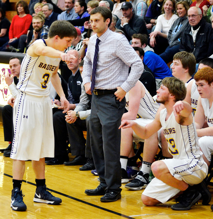 . Jeff Forman/JForman@News-Herald.com Treammate Josh Garrett gives Freiling some advice as he takes the court.