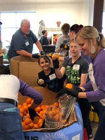KRE Staff volunteering at the NB Food Bank