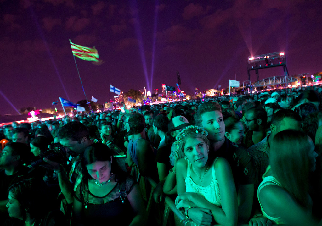 . Kendall Becker, 17, and Kenneth Ruddy, 17, wait for The Cure  at the Austin City Limits Music Festival, Saturday, Oct. 5, 2013 at Zilker Park in Austin, Texas. (AP Photo/Austin American-Statesman, Jay Janner)