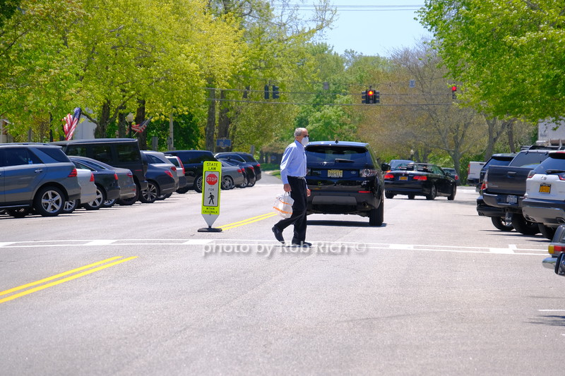 man crossing street with mask in Southampton May 21, 2020: Hamptons photo by Rob Rich/SocietyAllure.com ©2020 robrich101@gmail.com 516-676-3939