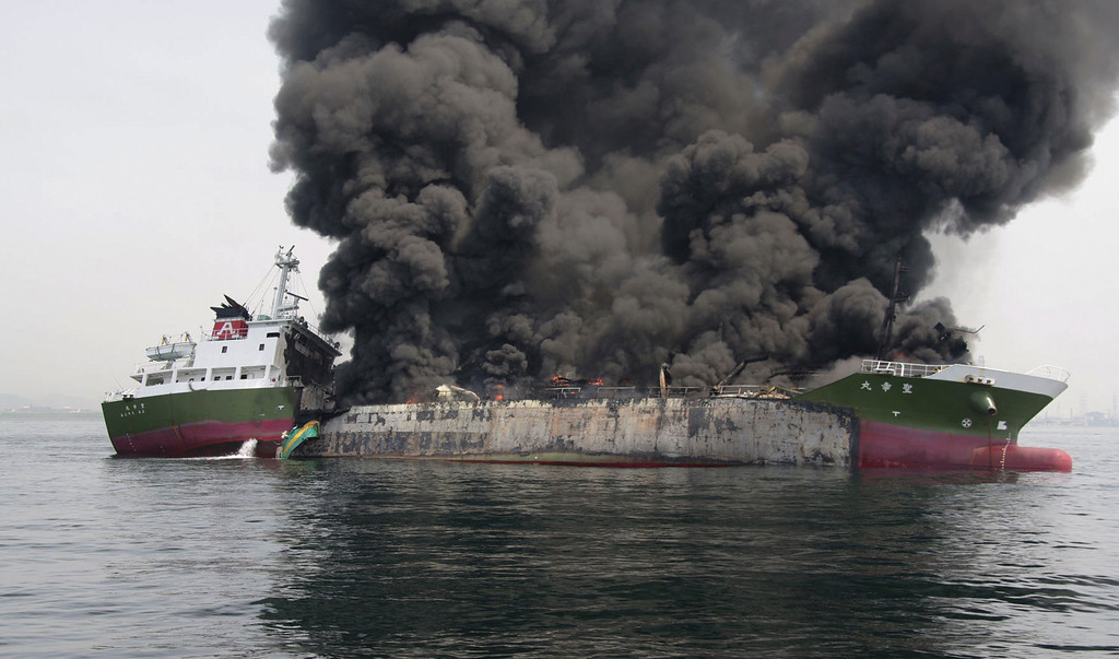 . In this photo released by Japan\'s 5th Regional Coast Guard, clouds of black smoke billow from Shoko Maru, a 998-ton Japanese oil tanker, after it exploded off the southwest coast near Himeji port, western Japan, Thursday, May 29, 2014. One of the eight people aboard is missing and the other seven were injured, according to the coast guard. (AP Photo/Japan\'s 5th Regional Coast Guard)