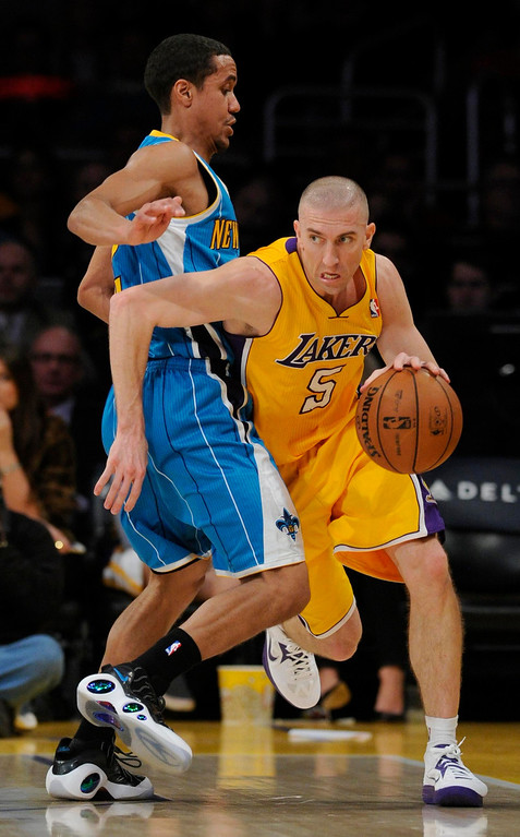 . Hornets#22 Brian Roberts guards Lakers#5 Steve Blake in his first game back after a long injury. The Lakers played the New Orleans Hornets in a game at Staples Center in Los Angeles, CA 1/29/2013 (John McCoy/Los Angeles Daily News)