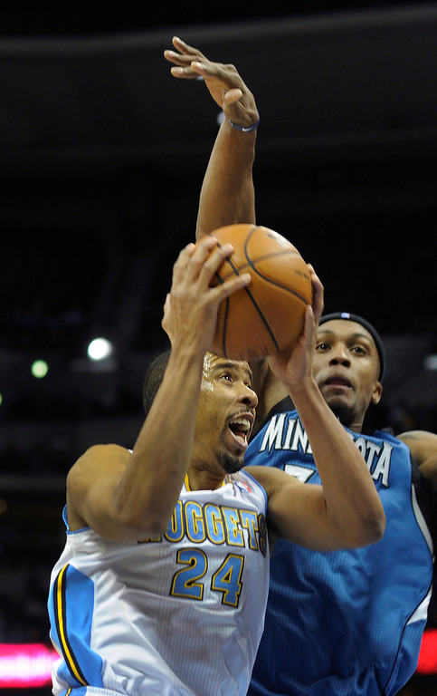 . Denver guard Andre Miller (24) made a move past Wolves forward Dante Cunningham (33) in the second half. The Minnesota Timberwolves took a bite out of the Denver Nuggets winning 101-97 at the Pepsi Center Thursday night, January 3, 2013. Karl Gehring/The Denver Post
