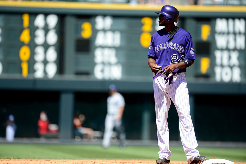 . Colorado Rockies center fielder Dexter Fowler (24) stands on second after hitting a double off of San Diego Padres starting pitcher Clayton Richard (33) during the action in Denver. The Colorado Rockies hosted the San Diego Padres at Coors Field on Sunday, June 9, 2013. (Photo by AAron Ontiveroz/The Denver Post)