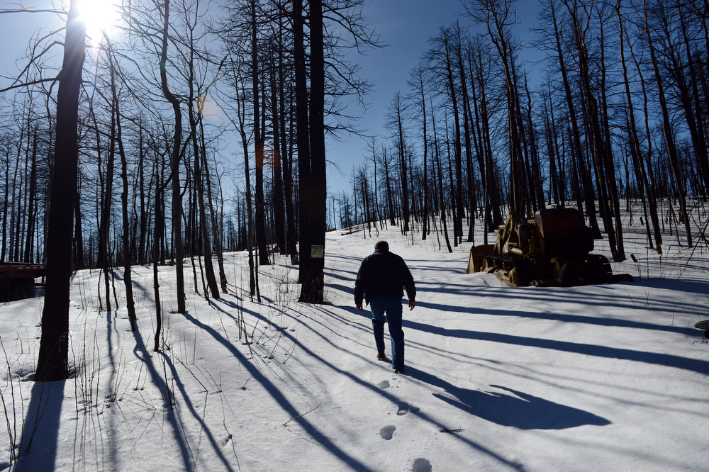 . Scott Appel tours his property that was destroyed in the Lower North Fork fire last year, in Unincorporated Jefferson County, CO March 14, 2013. Appel\'s wife, Ann, is one of three people that died in the fire that destroyed 27 homes. Appel is among nearly 100 people who have made claims for damages against the state.  (Photo By Craig F. Walker/The Denver Post)