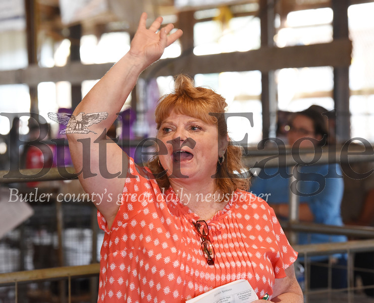 Harold Aughton/Butler Eagle: Auctioneer Beth Hillman acknowledges a bid during the 4-H-FFA Livestock Auction at the Butler Farm Show.