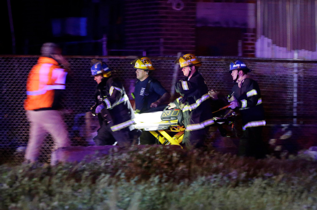 . Emergency personnel transport a victim at the scene of a train wreck, Tuesday, May 12, 2015, in Philadelphia. An Amtrak train headed to New York City derailed and crashed in Philadelphia. (AP Photo/Matt Slocum)
