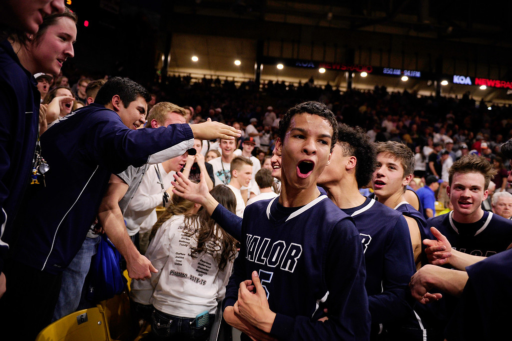 . Jeremy Randle (5) of Valor Christian celebrates with the crowd after defeating Longmont at the Coors Events Center on March 11, 2016 in Boulder, Colorado. Valor Christian defeated Longmont 58-53 to advance to the 4A finals of Colorado state basketball tournament.  (Photo by Brent Lewis/The Denver Post)